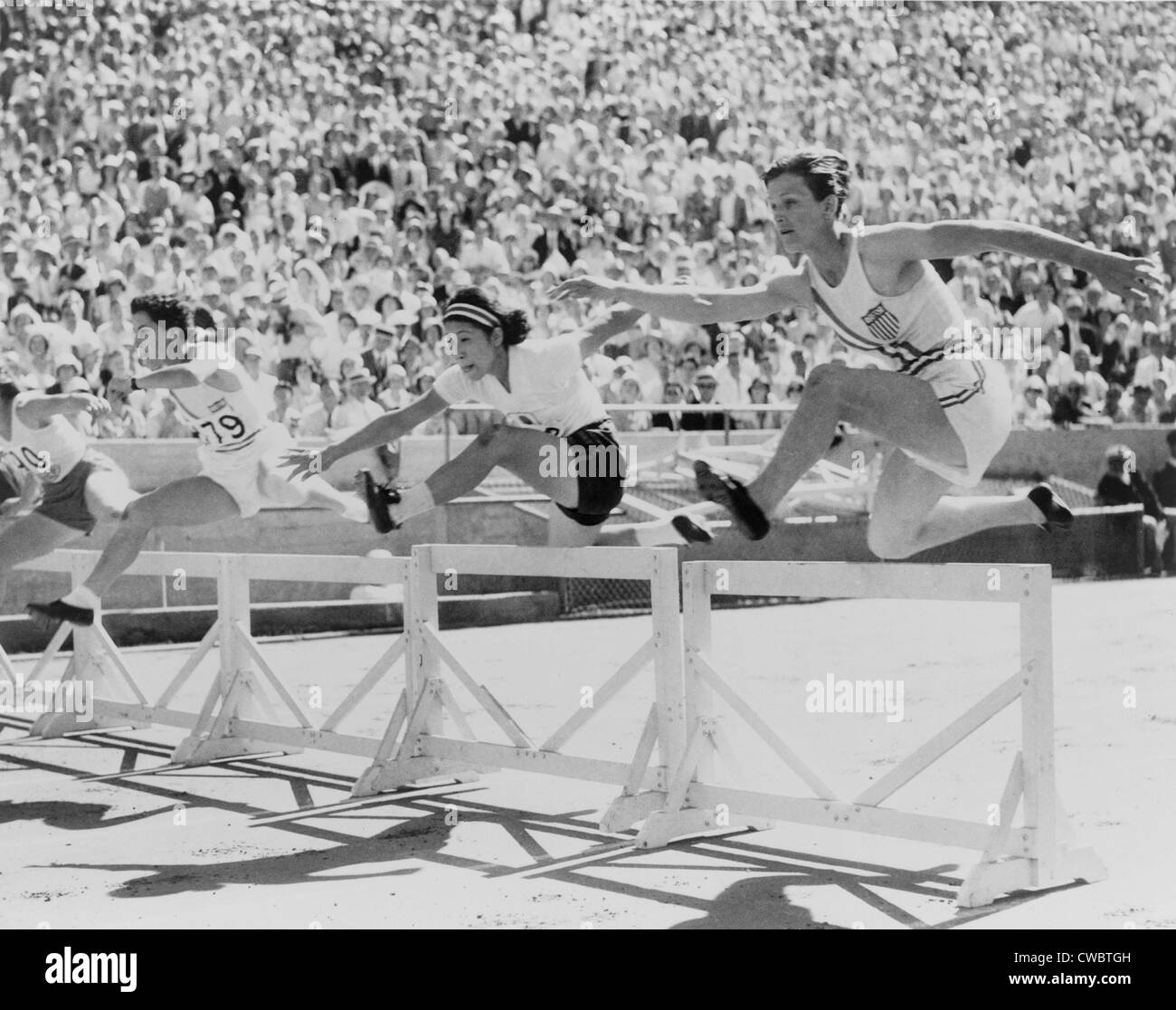 Mildred 'Babe' Didrikson, (1911-1956), running in the first heat of the 80-meter hurdles, at the 1932 Olympics - Stock Image
