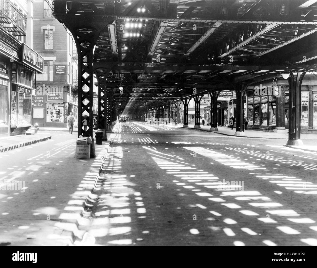 New York City's west side elevated railroad at Greenwich Street, New York in the 1930s. - Stock Image