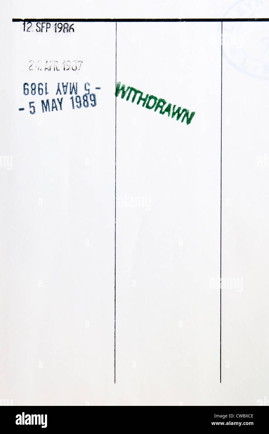 A withdrawn library book with the word WITHDRAWN stamped on the return date sheet. - Stock Image