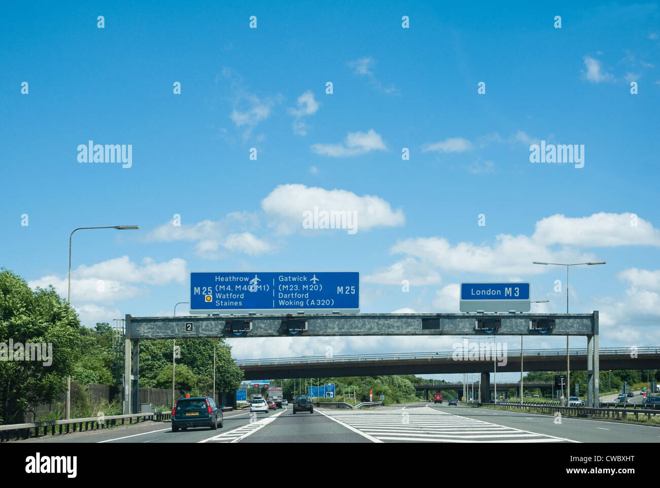 M25 Motorway signs - with separating lanes for either Heathrow and Gatwick Airports to the left - or London M3 to - Stock Image