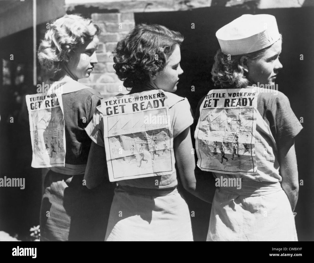 Textile workers displaying picket signs pinned on their backs during Labor Day demonstration in Gastonia, N.C. 1934. - Stock Image