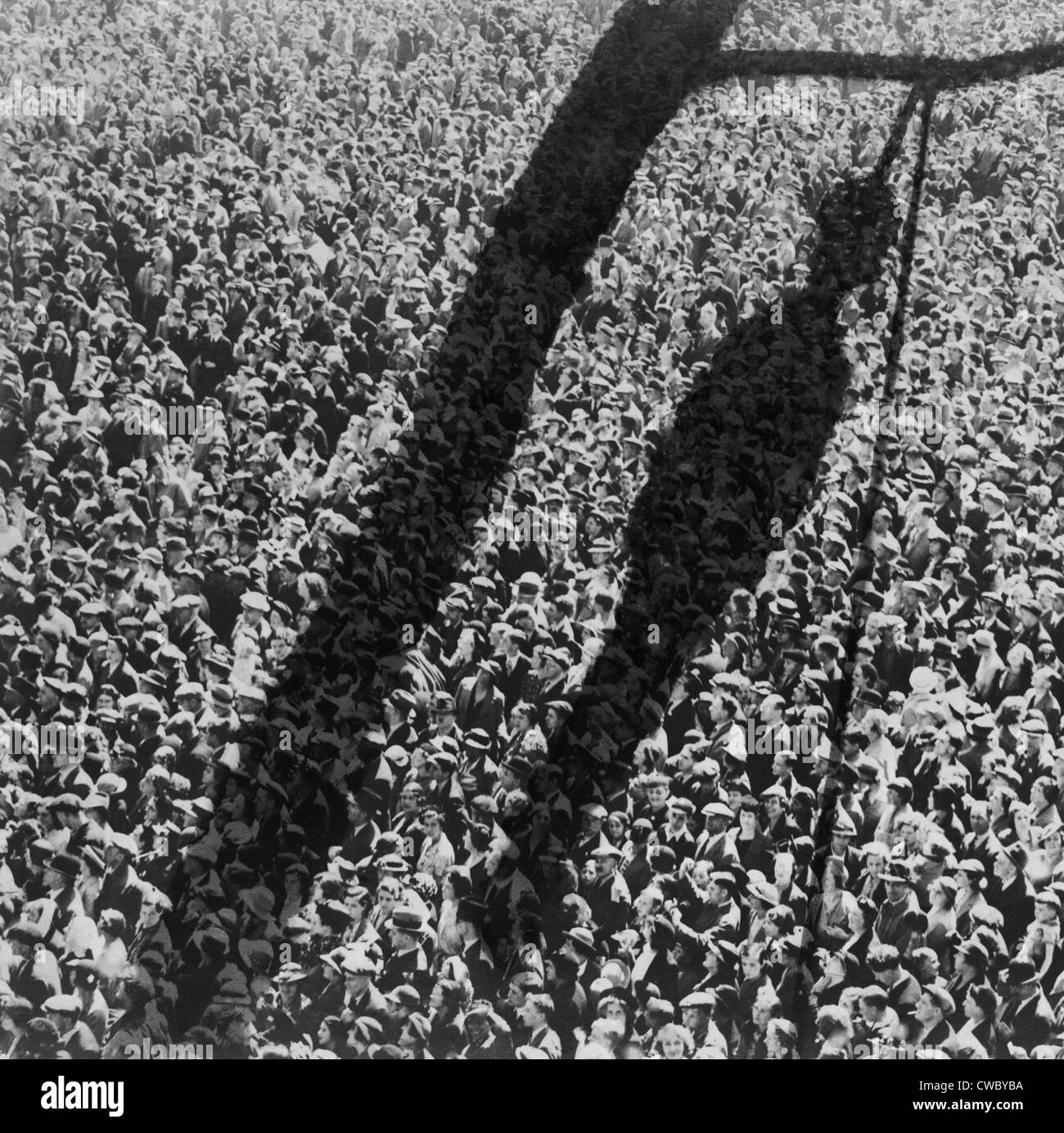 Lynching. The shadow of lynching painted over a crowd of white people.  In the 1920 and 1930s, the NAACP created - Stock Image