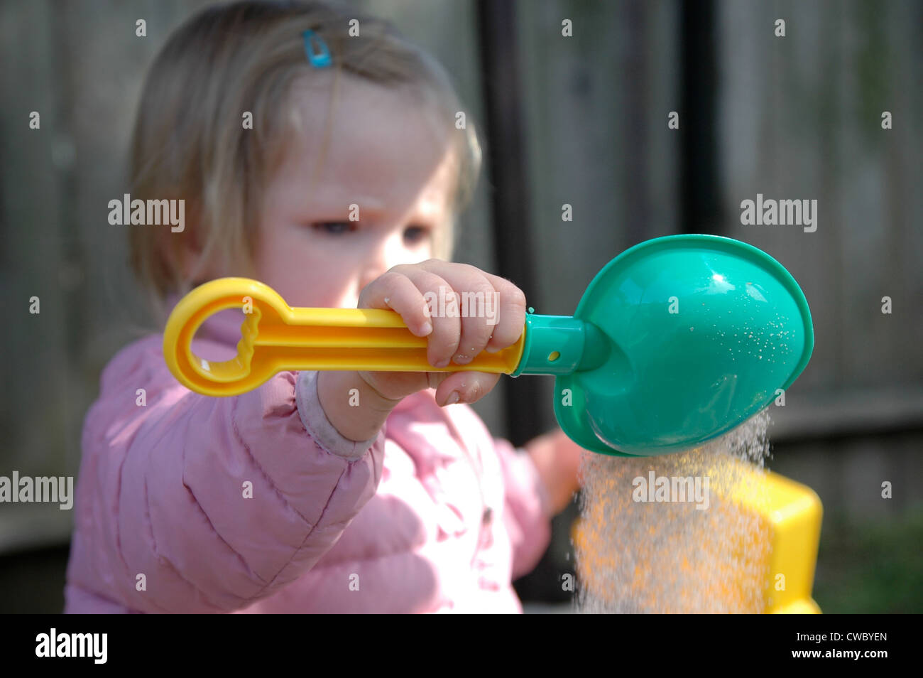 Toddler Plays In Sandbox Stock Photo