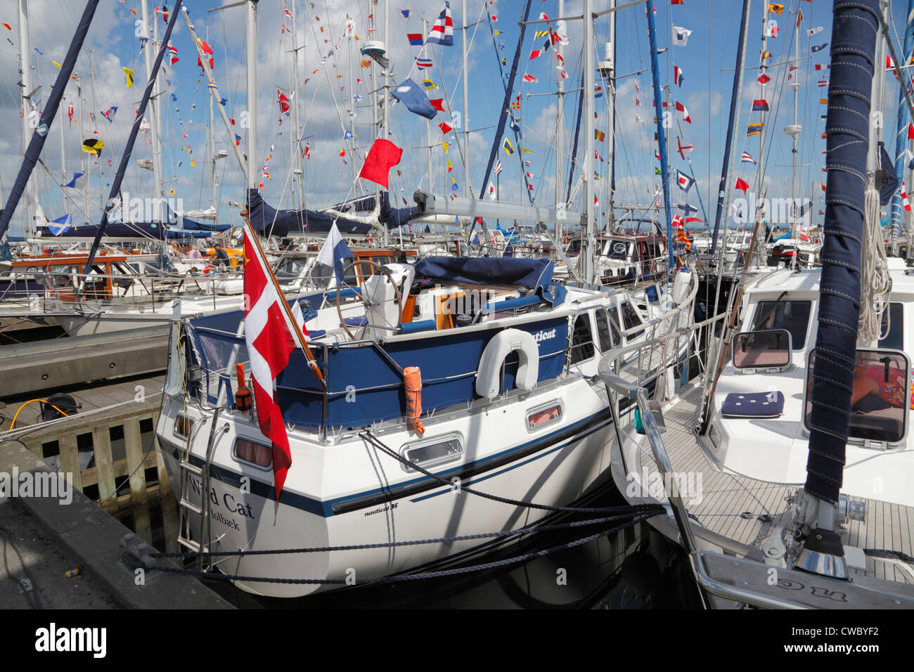 Nauticat motorsailers decorated with signal flags in the Scandinavian Nauticat Rally 2012 in Rungsted Harbour, Denmark. - Stock Image