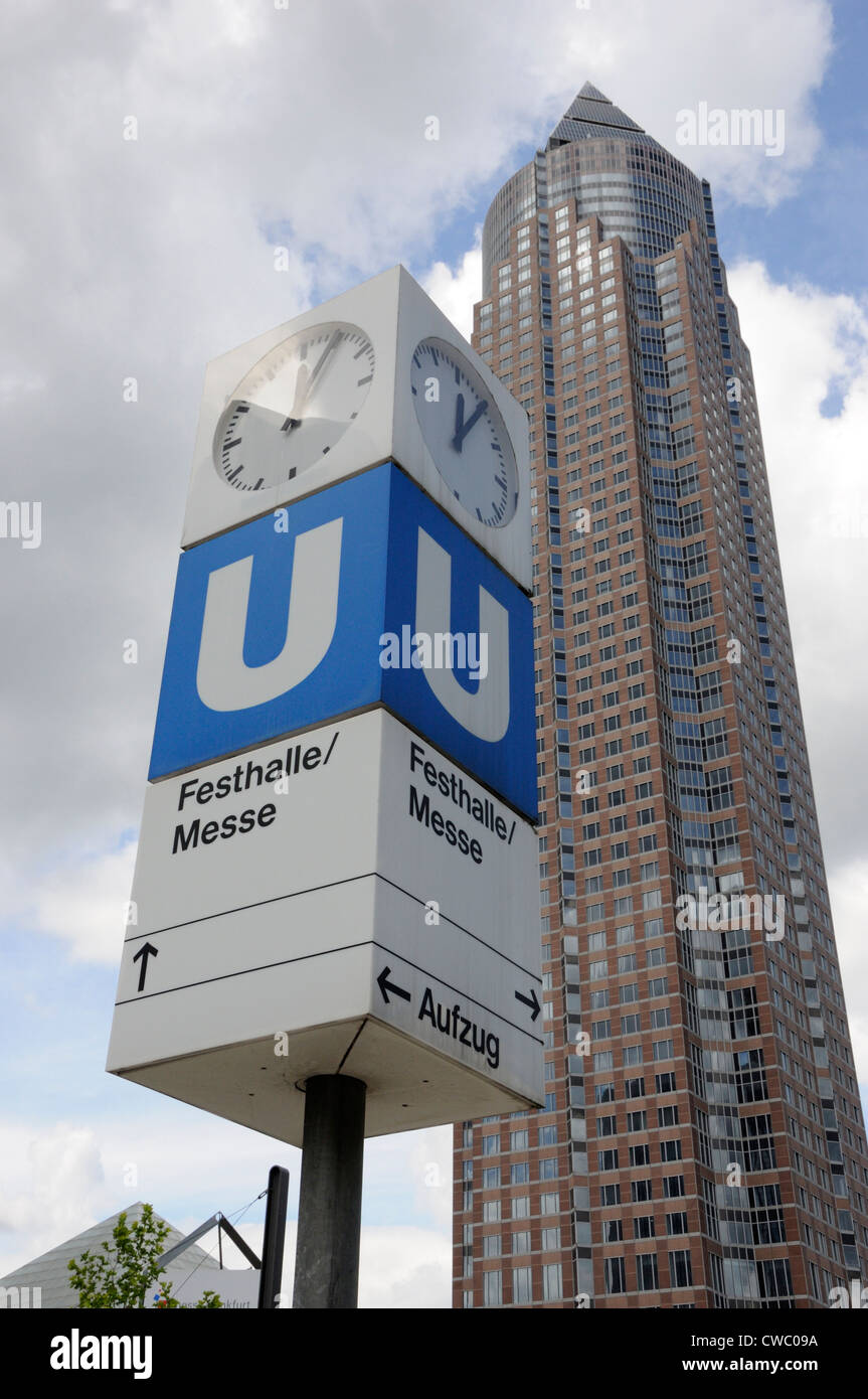 Sign for the Festhalle/Messe U-bahn station with the Messeturm in the background, Frankfurt, Germany. Stock Photo