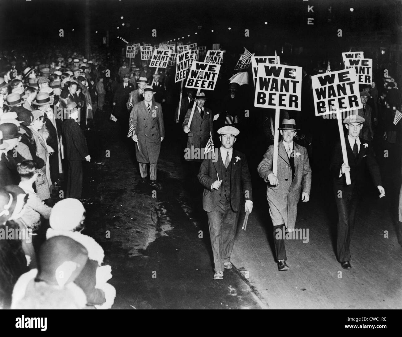 Labor union members protesting Prohibition in Newark New Jersey carrying signs reading 'We want beer.' October 1931. Stock Photo