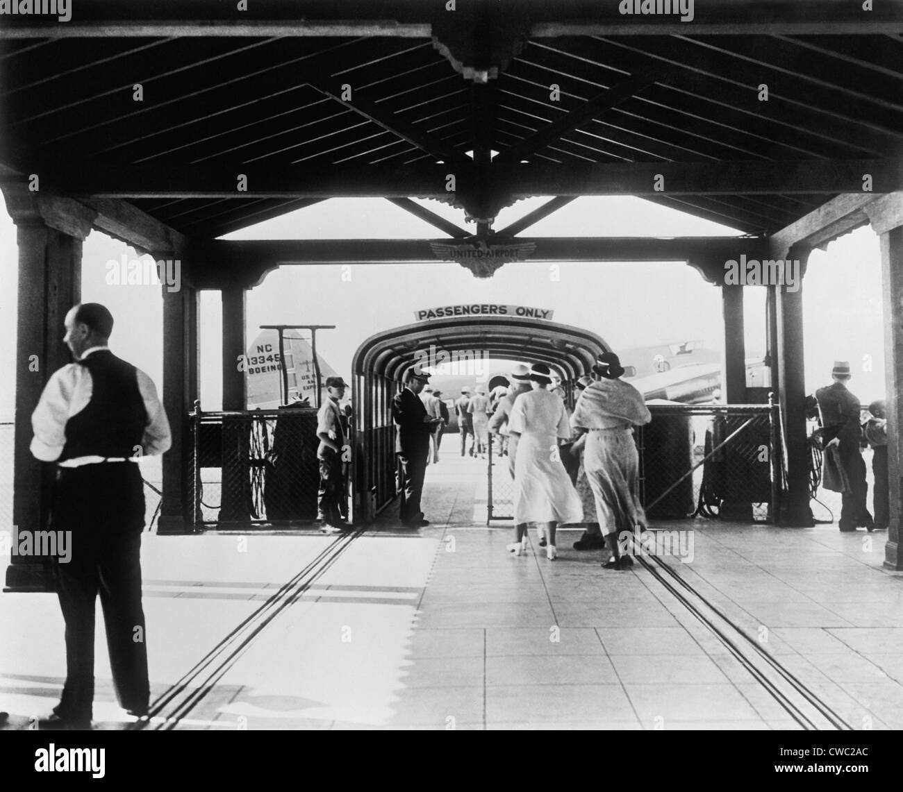 Passengers embark at Washington D.C. area airport in the 1930s. LC-DIG-hec-14557 - Stock Image