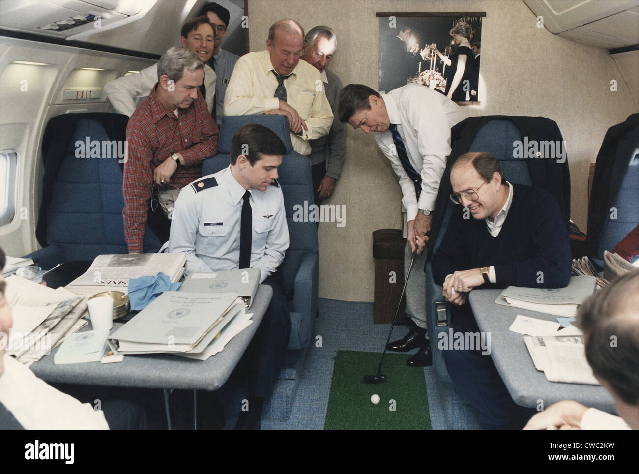 President Reagan putting a golf ball around Air Force One while flying to Geneva Summit with Soviet Union's - Stock Image