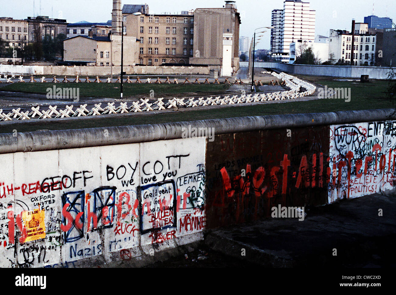 The Berlin Wall separated Communist-controlled East Germany from West Berlin. White apartments of West Berlin contrast - Stock Image