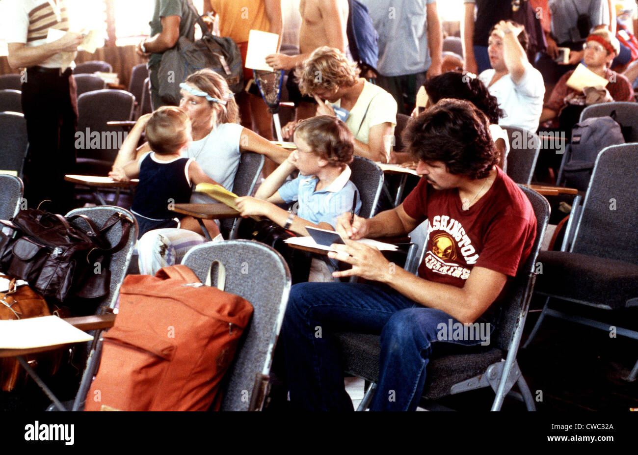 U.S. civilians awaiting evacuation from Grenada during the October 1983 U.S. invasion. American medical students - Stock Image