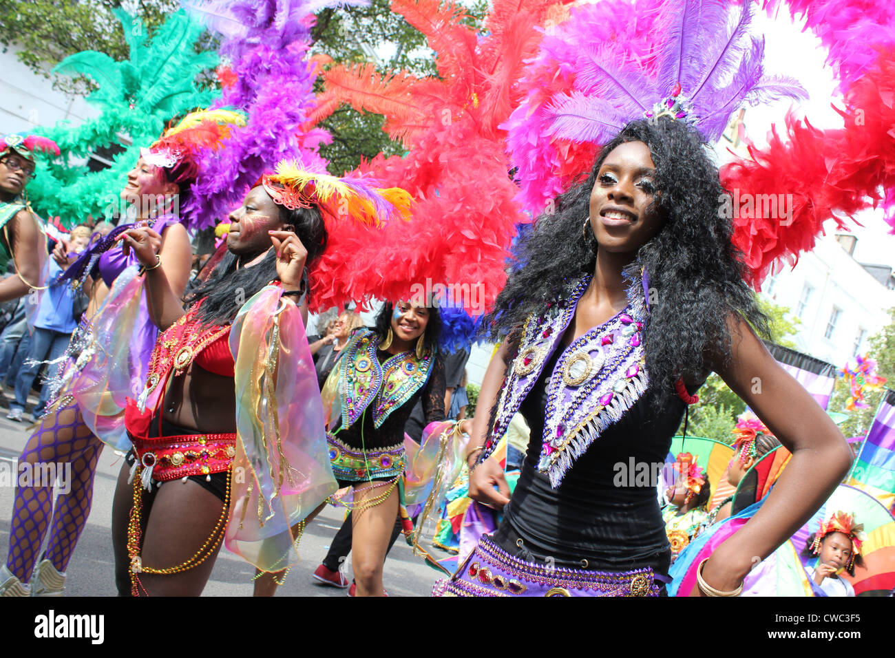 Women dancing at Parade Annual Notting  Hill Carnival 2011 - Stock Image