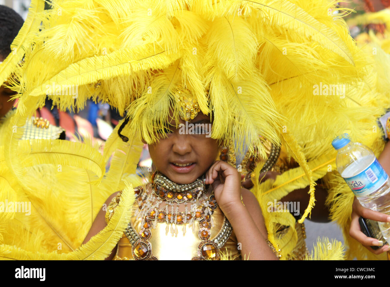 Young child in costume at Annual Notting  Hill Carnival 2011 - Stock Image
