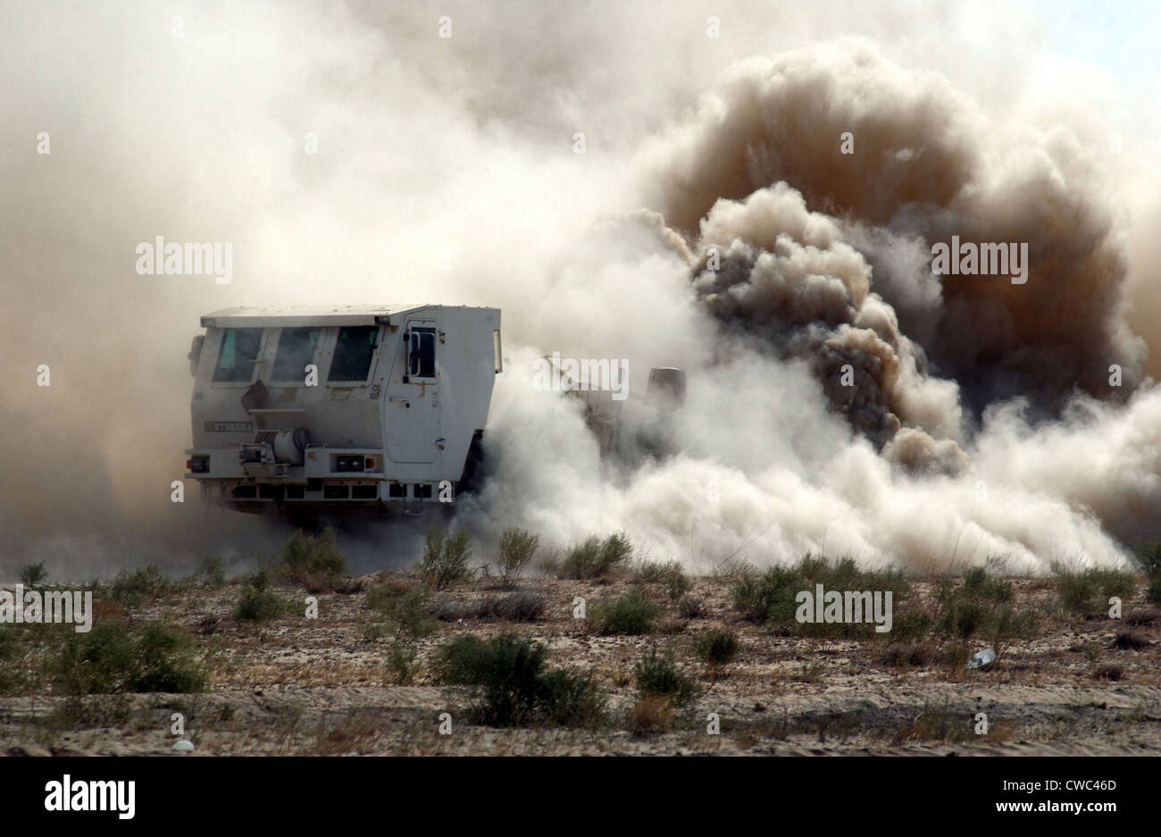 U.S. soldiers employ a mine clearing vehicle near the Bagram Air Base Afghanistan. The Hydrema a Danish made vehicle - Stock Image