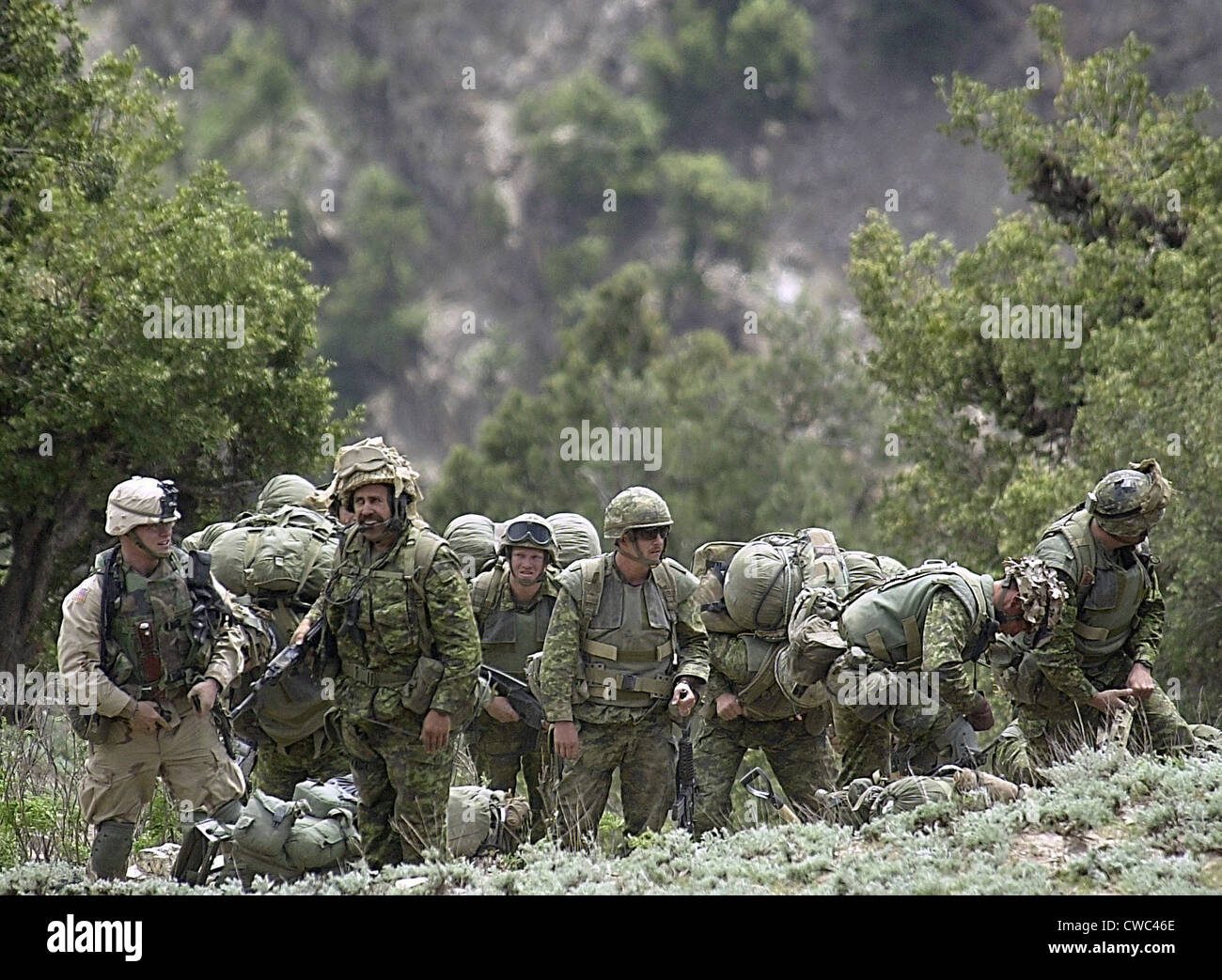 Coalition soldiers from US Canada and Afghanistan at a landing zone in 7 500-foot mountains in the Tora Bora region - Stock Image
