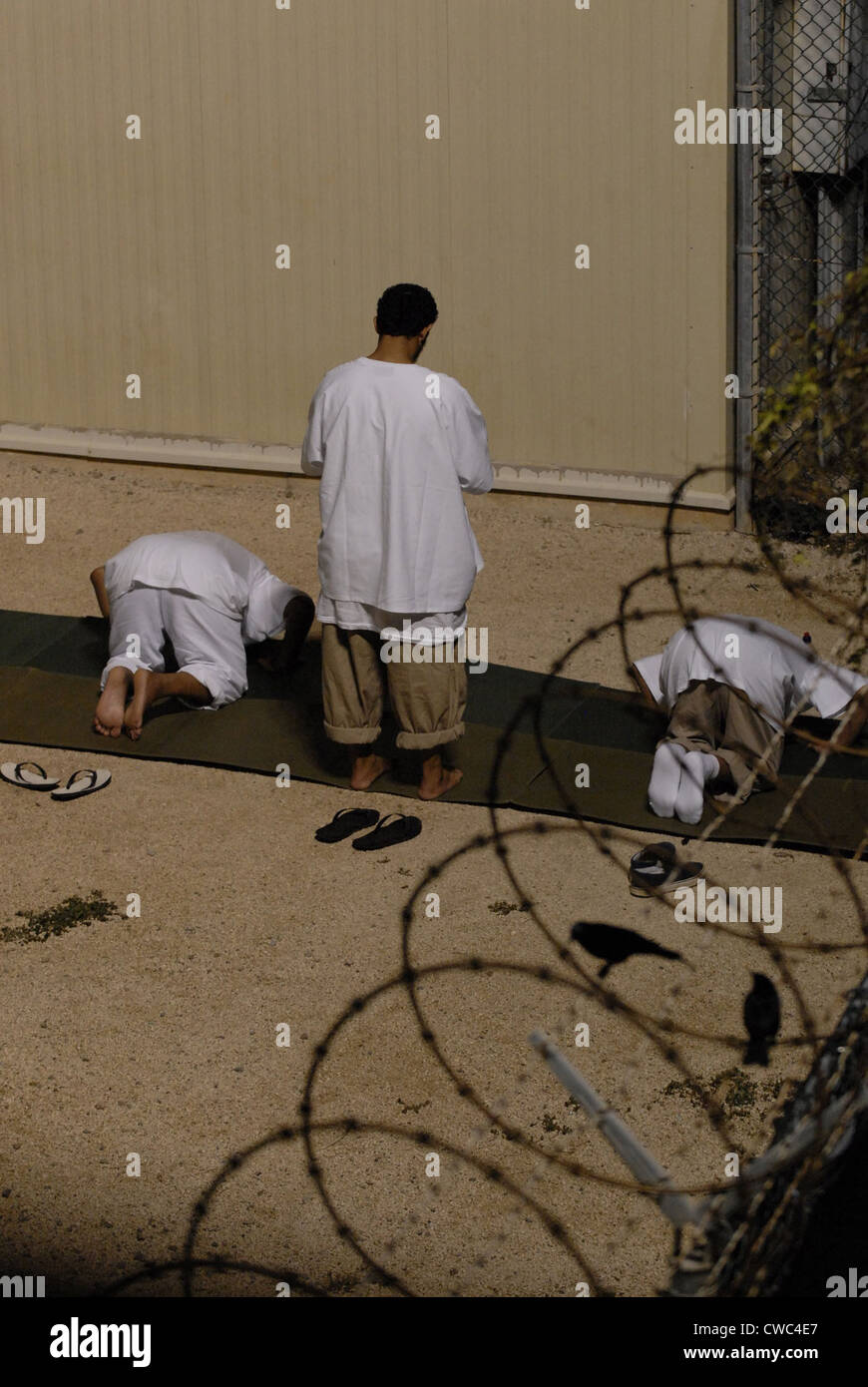 Islamic detainees pray at Camp Delta the military prison at Naval Station Guantanamo Bay Cuba. Oct. 28 2009., Photo - Stock Image