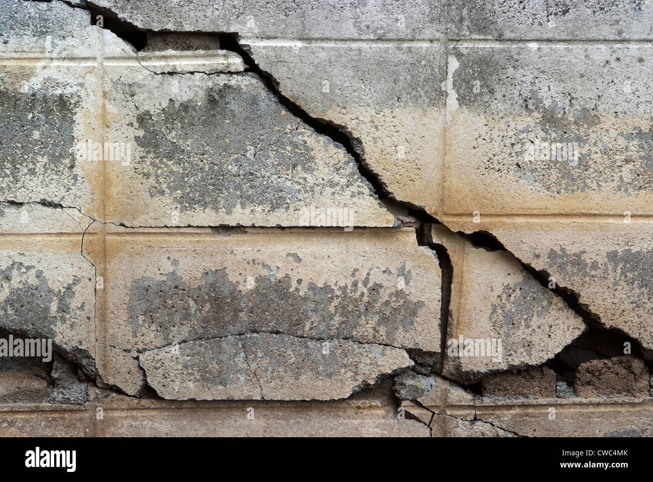 crack at concrete wall , grunge background - Stock Image