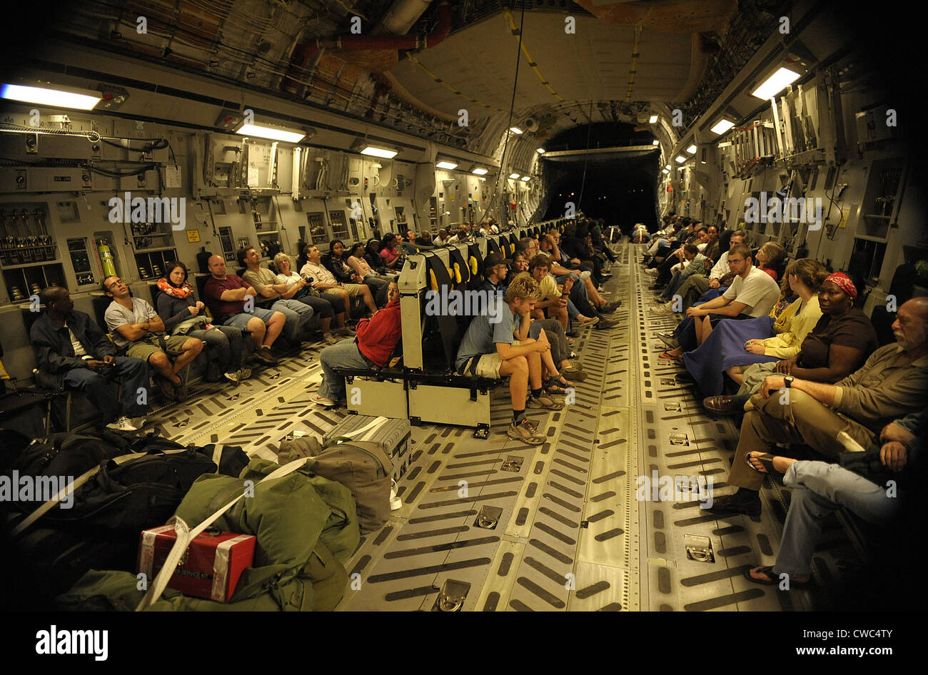 US citizens evacuated from earthquake stricken Haiti in a Air Force C-17 transport. Jan. 15 2010. (BSLOC_2011_12 - Stock Image