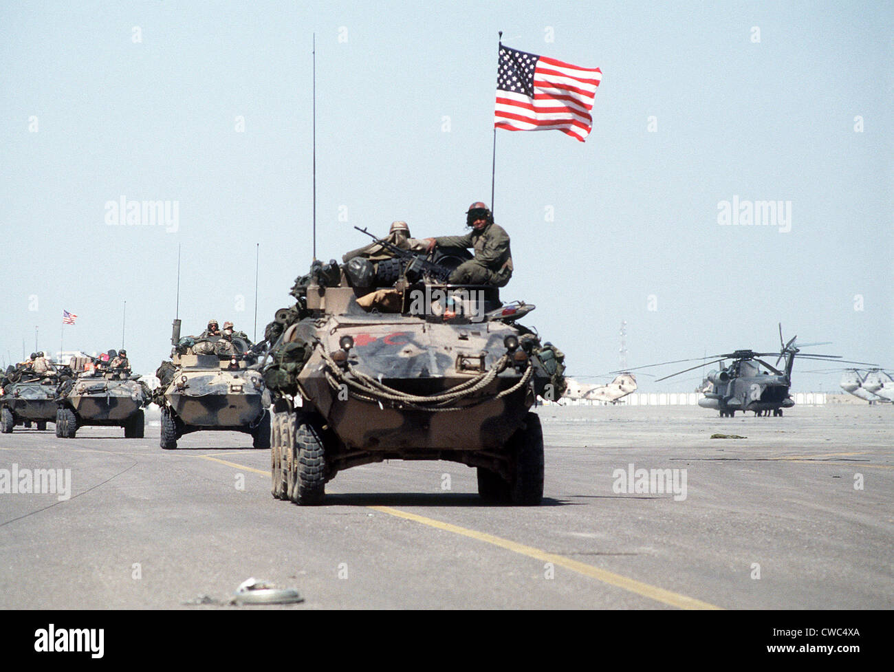 US Marines roll into Kuwait International Airport in light armored vehicles after the retreat of Iraqi forces during - Stock Image