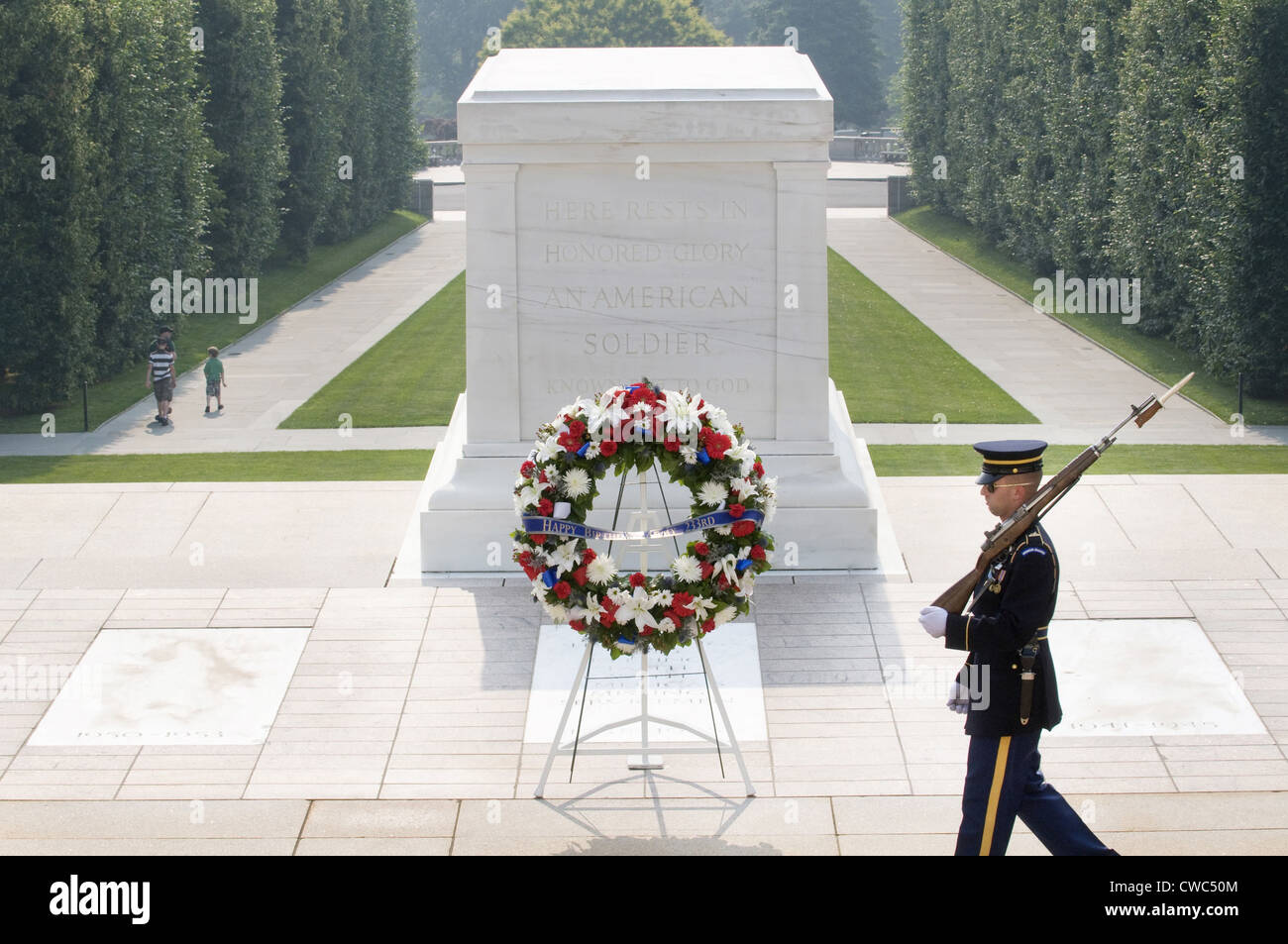 A soldier guards the Tomb of the Unknown Soldier at Arlington National Cemetery. Army's senior leadership laid - Stock Image