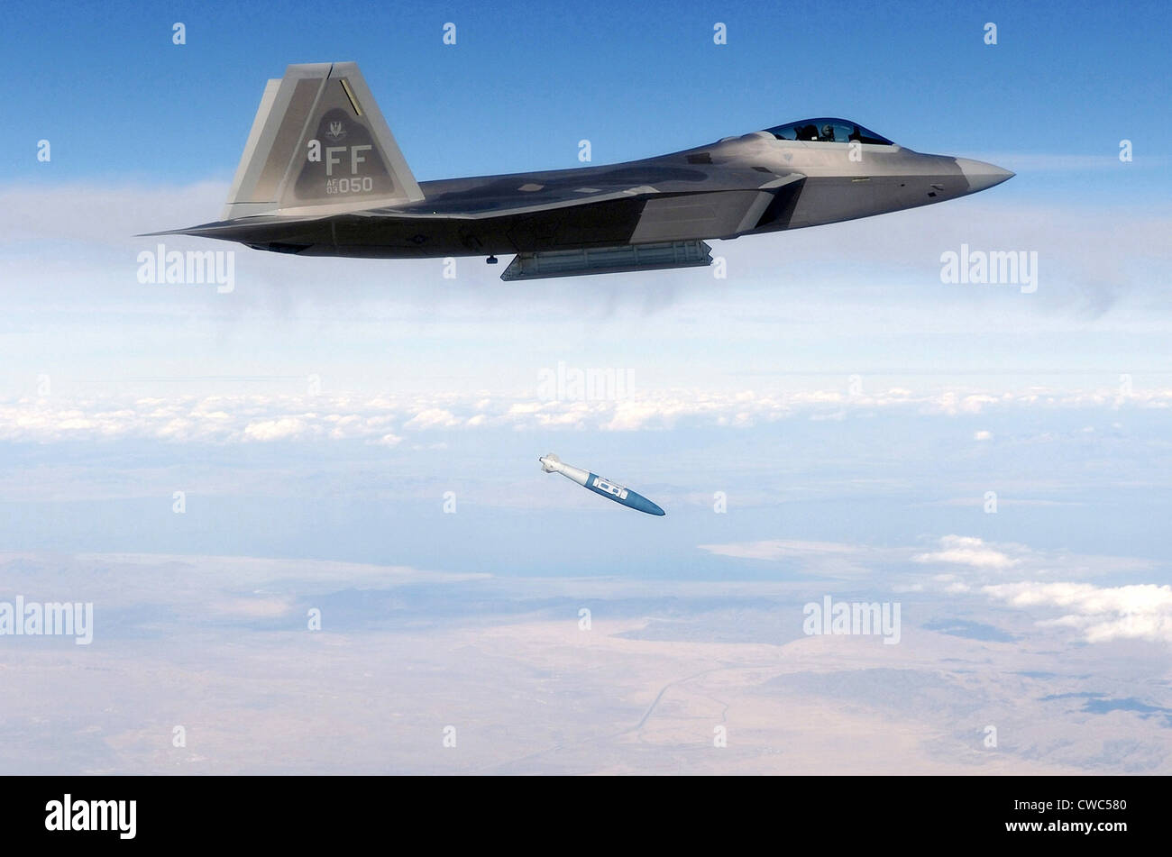 F-22 Raptor releases a 1 000-pound over the Utah Test and Training Range during weapons evaluation. October 20 2005. Stock Photo