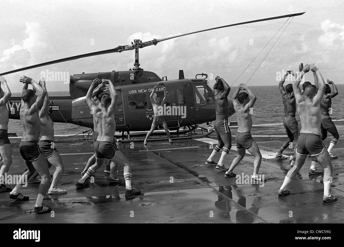 Marines doing jumping jacks on the deck of the amphibious assault ship USS NEW ORLEANS. Aug. 1 1982. (BSLOC 2011 Stock Photo