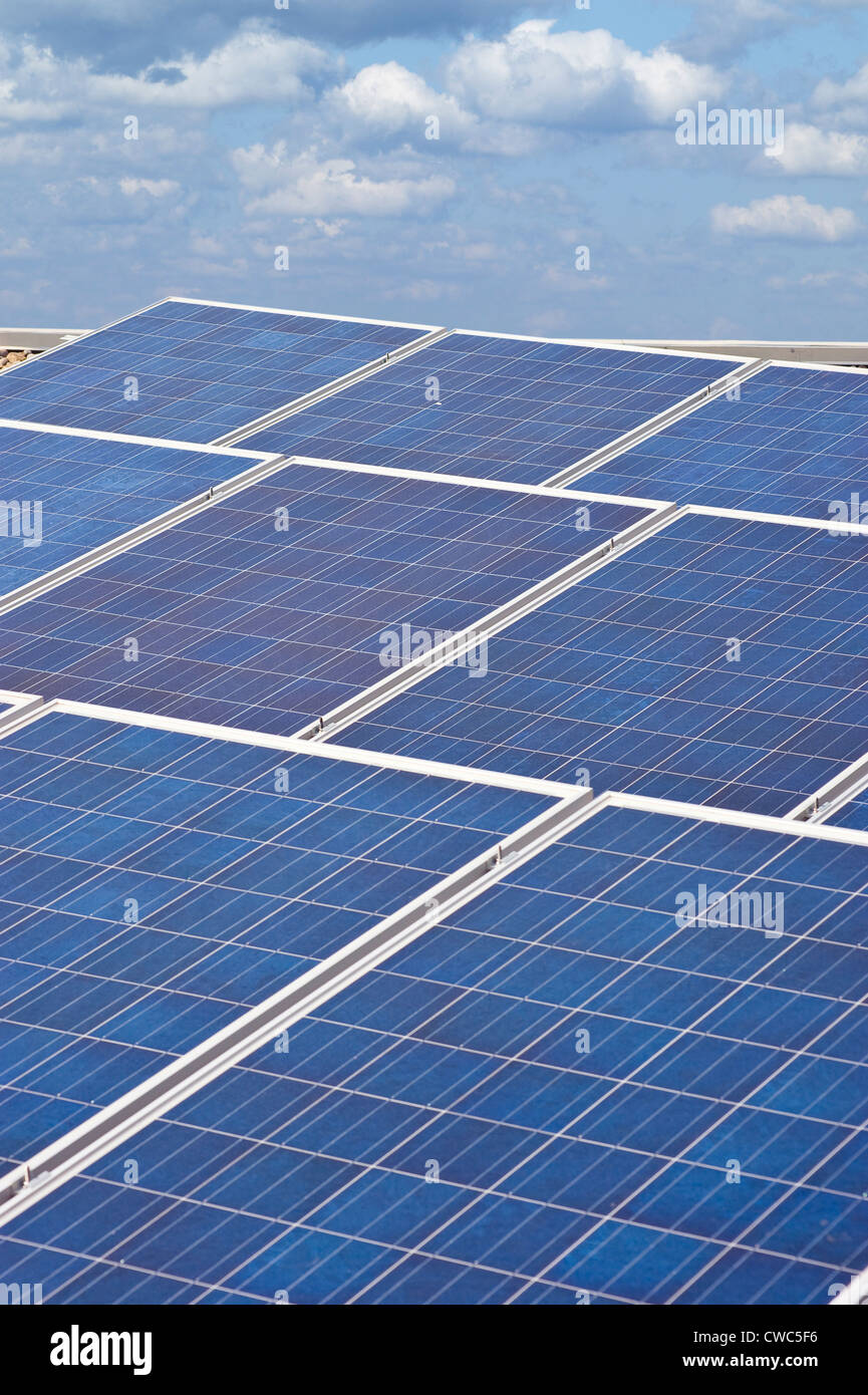 Roof Top Solar Panels With Blue Sky & Clouds - Stock Image