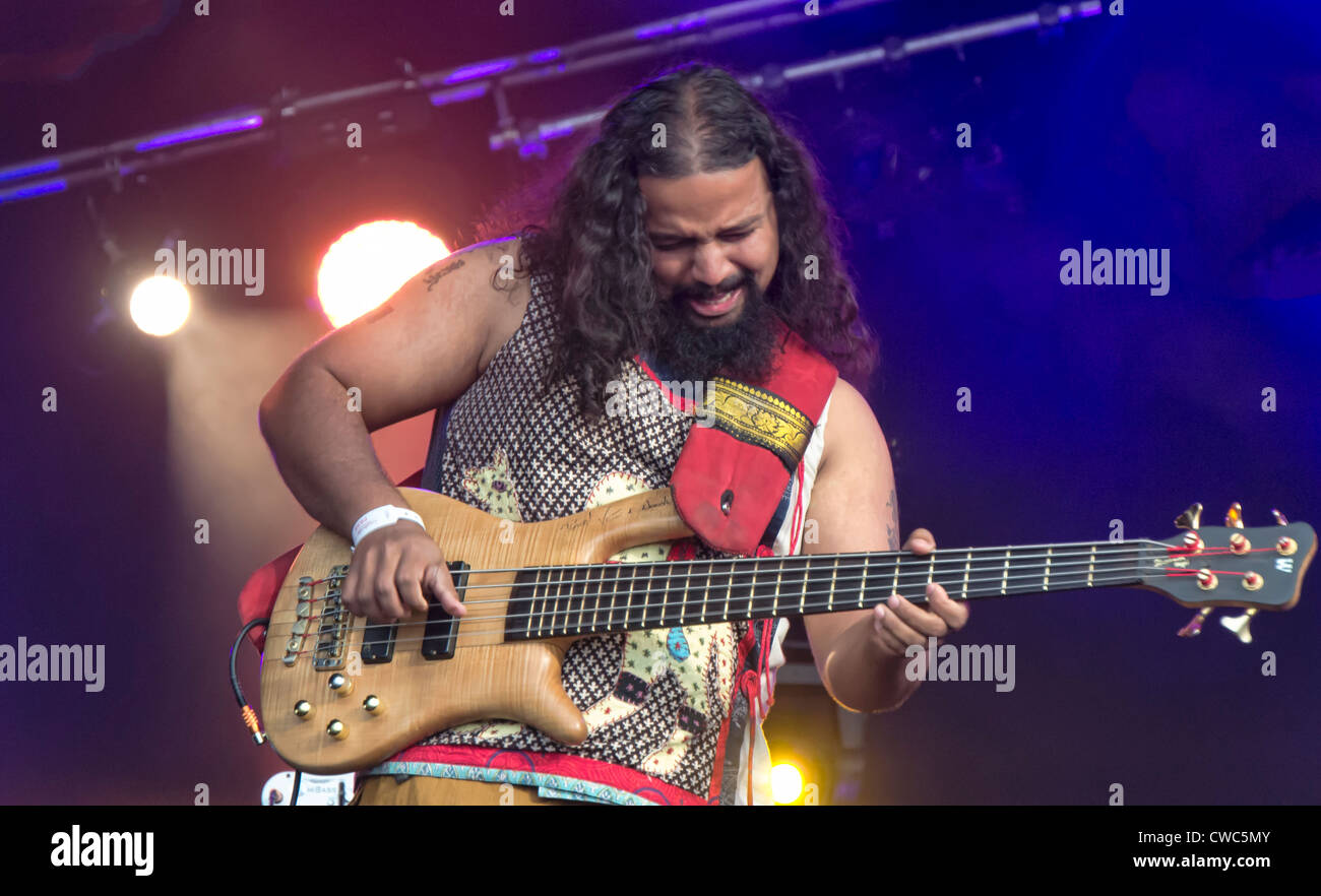 CAMBRIDGE UK JULY 27 2012: Raghu Dixit, of Indian pop rock rock band, performing at the Cambridge Folk Festival, - Stock Image