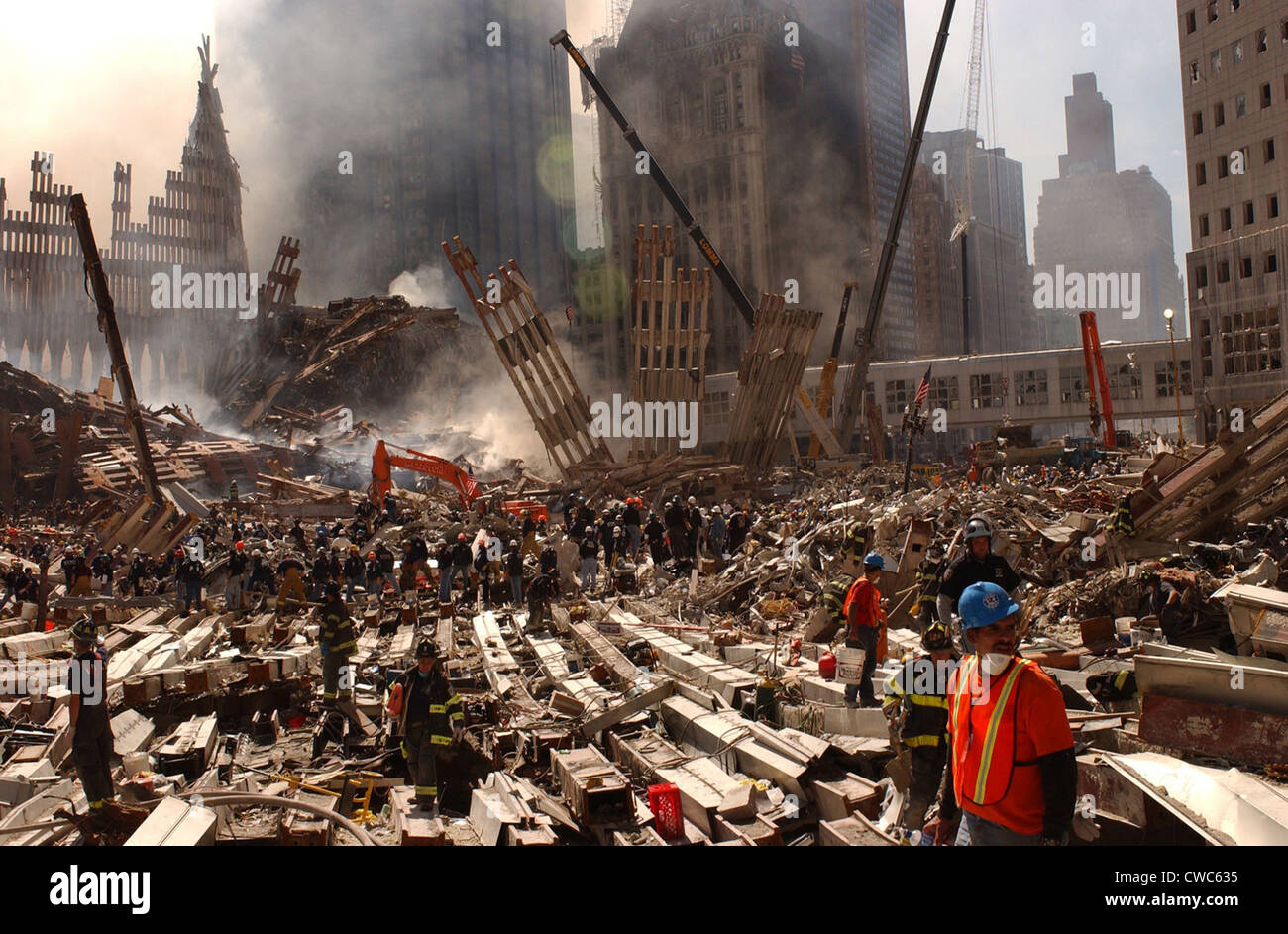 Rescue workers and firefighters in the wreckage at the World Trade Center two days after the 9-11 terrorist attacks - Stock Image