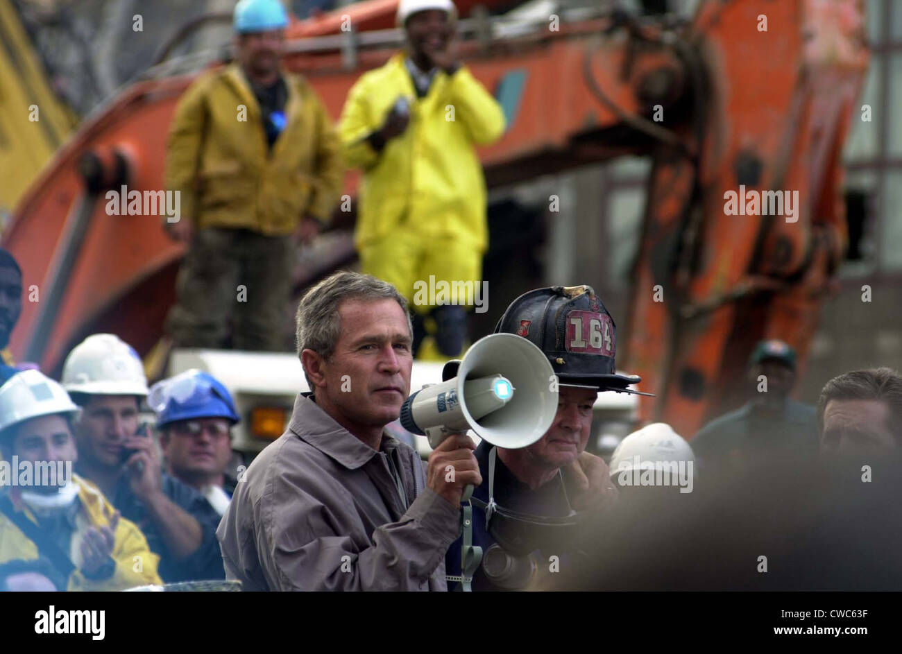 President Bush Addresses Rescue Workers With A Bullhorn At The Site
