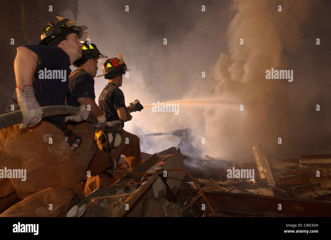 New York firefighters continue to battle blazes at Ground Zero eight days after the 9-11 terrorist attacks. Sept. - Stock Image