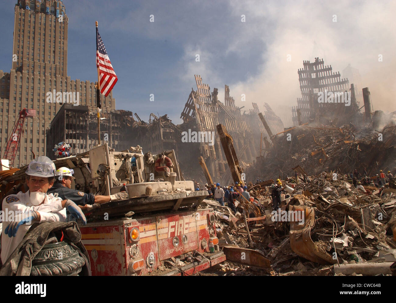 Urban search and rescue teams inspect the wreckage at the World Trade Center two days after the 9-11 terrorist attacks - Stock Image