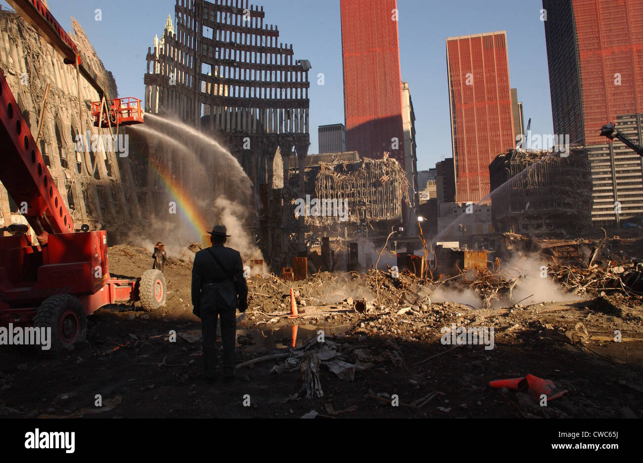 Workers spray the still smoldering rumble with water at the World Trade Center site six weeks after the 9-11 attacks. - Stock Image