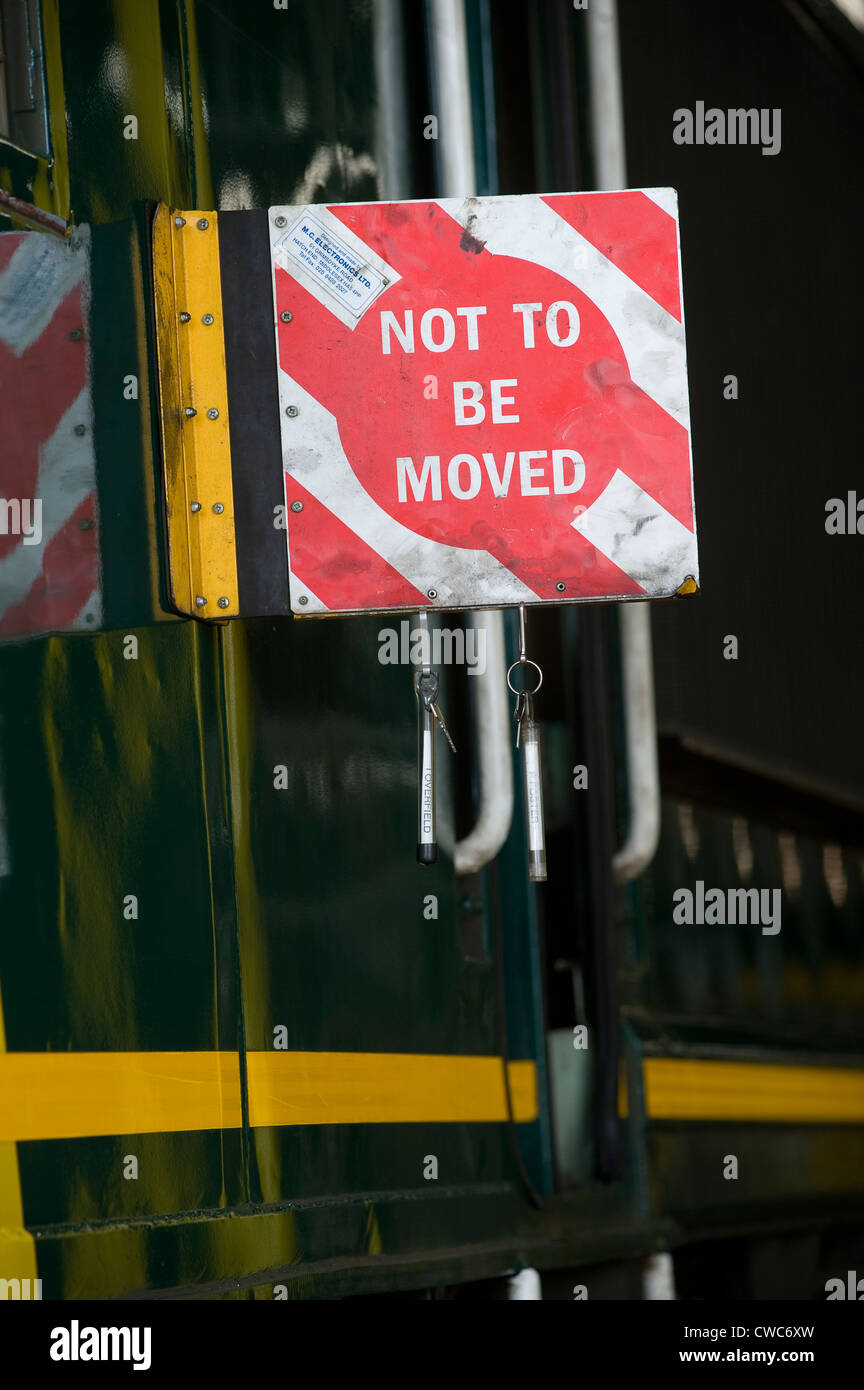 Not To Be Moved sign fixed to a train undergoing maintenance in a depot in England. - Stock Image