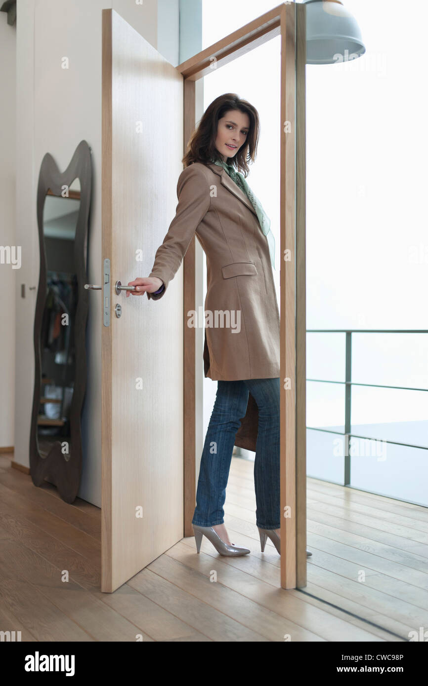 Woman Closing The Door Of A House Stock Photo 50057862