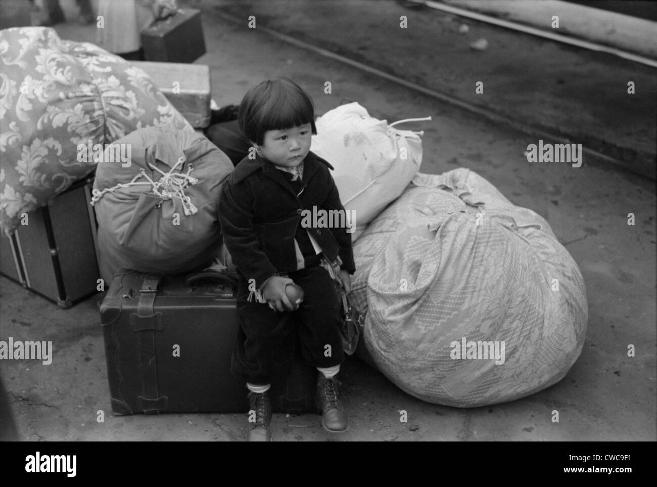 Japanese-American internee. Little child being evacuated with his parents to Owens Valley Internment Camp Manzanar - Stock Image