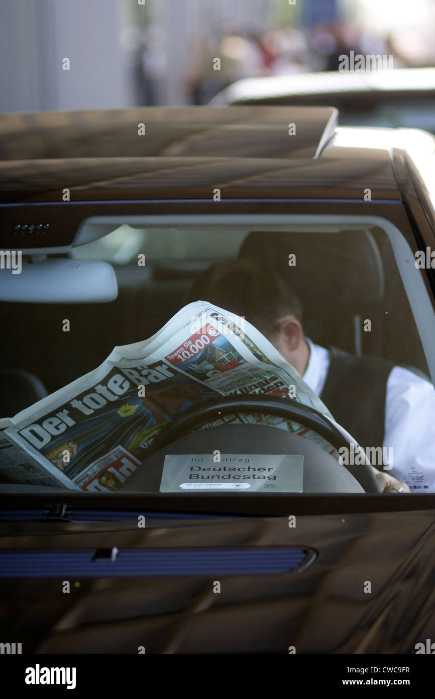 Berlin, driver reads tabloid Stock Photo