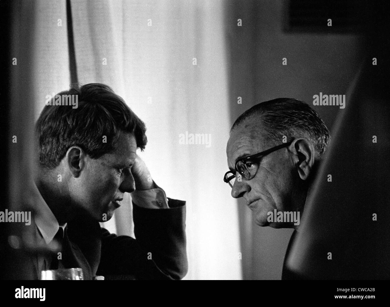 President Lyndon Johnson meeting with Robert Kennedy. The two men were unfriendly rivals, but supported each other - Stock Image