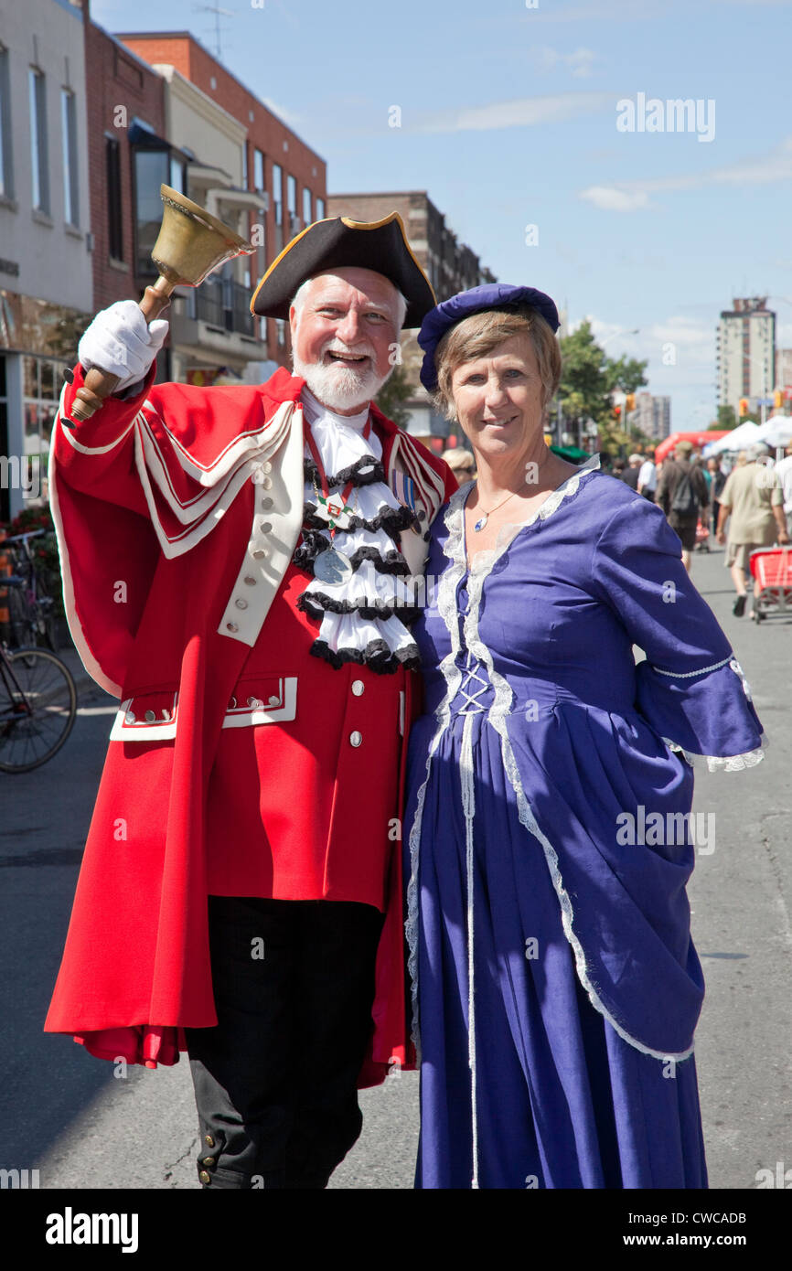 The Town Crier and Lady at Side Walk or Street Festival in Toronto;Ontario;Canada;on Bloor West Village - Stock Image