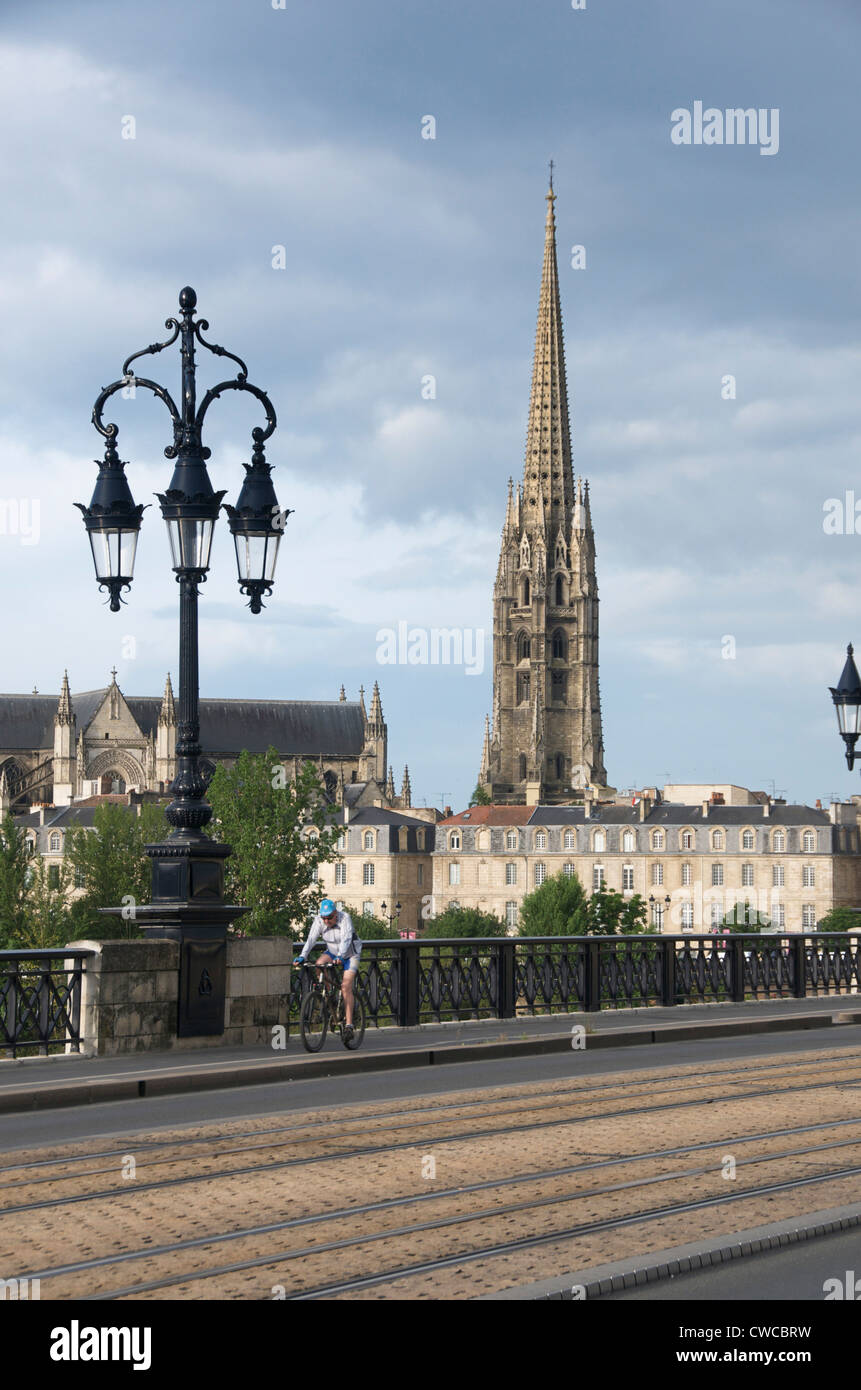 The old bridge Pont de Pierre, tower of Saint Michel church, Bordeaux city, Aquitaine, Gironde, France - Stock Image