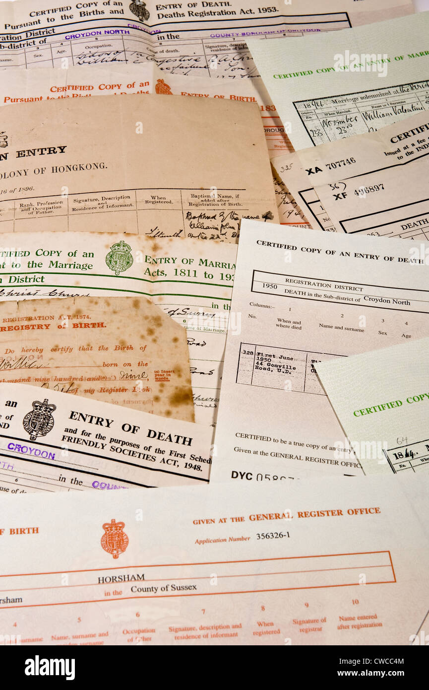 Some birth, death and marriage certificates, originals and copies. - Stock Image