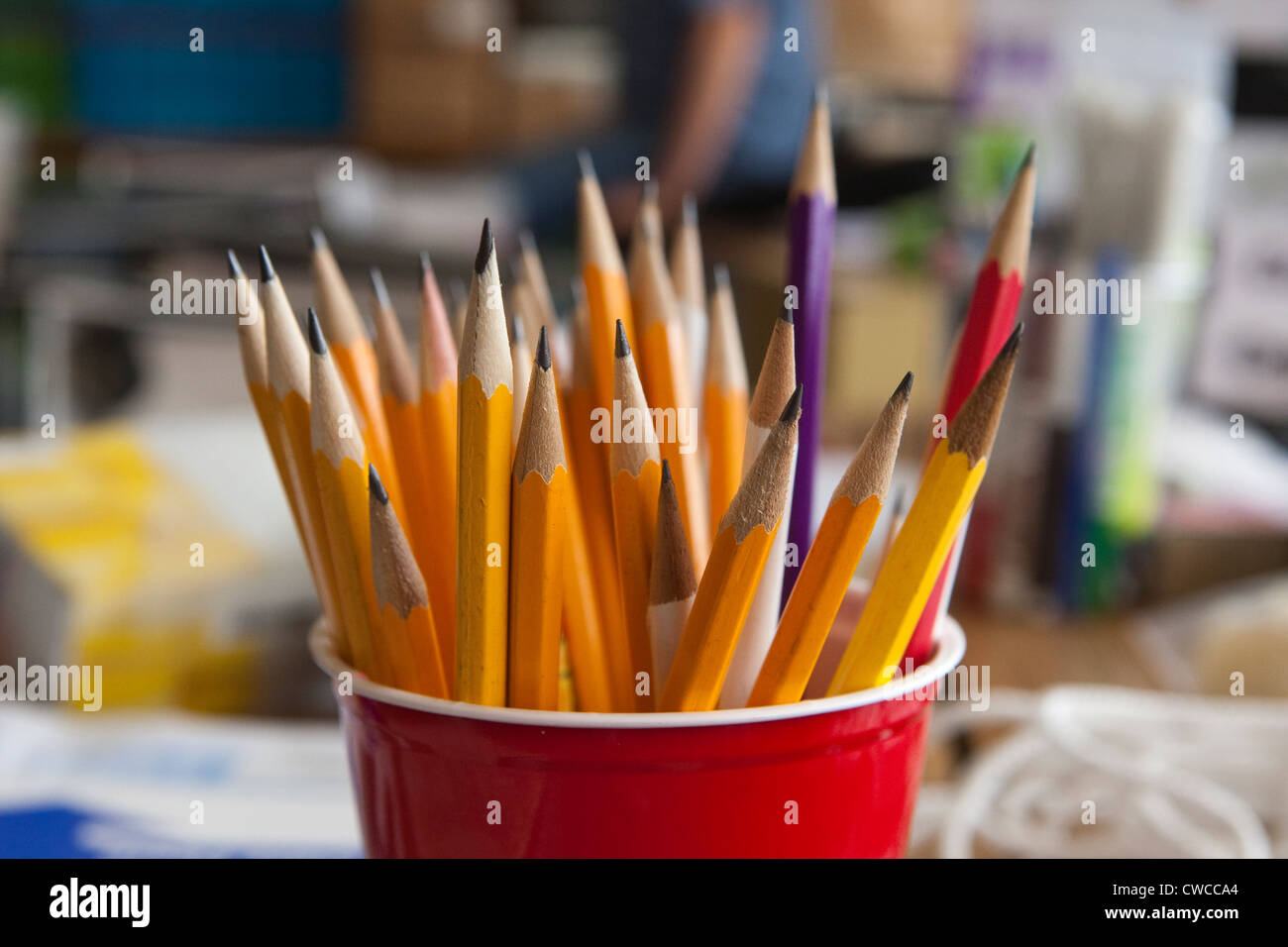 Red plastic cup full of sharpened #2 wood lead  pencils - Stock Image