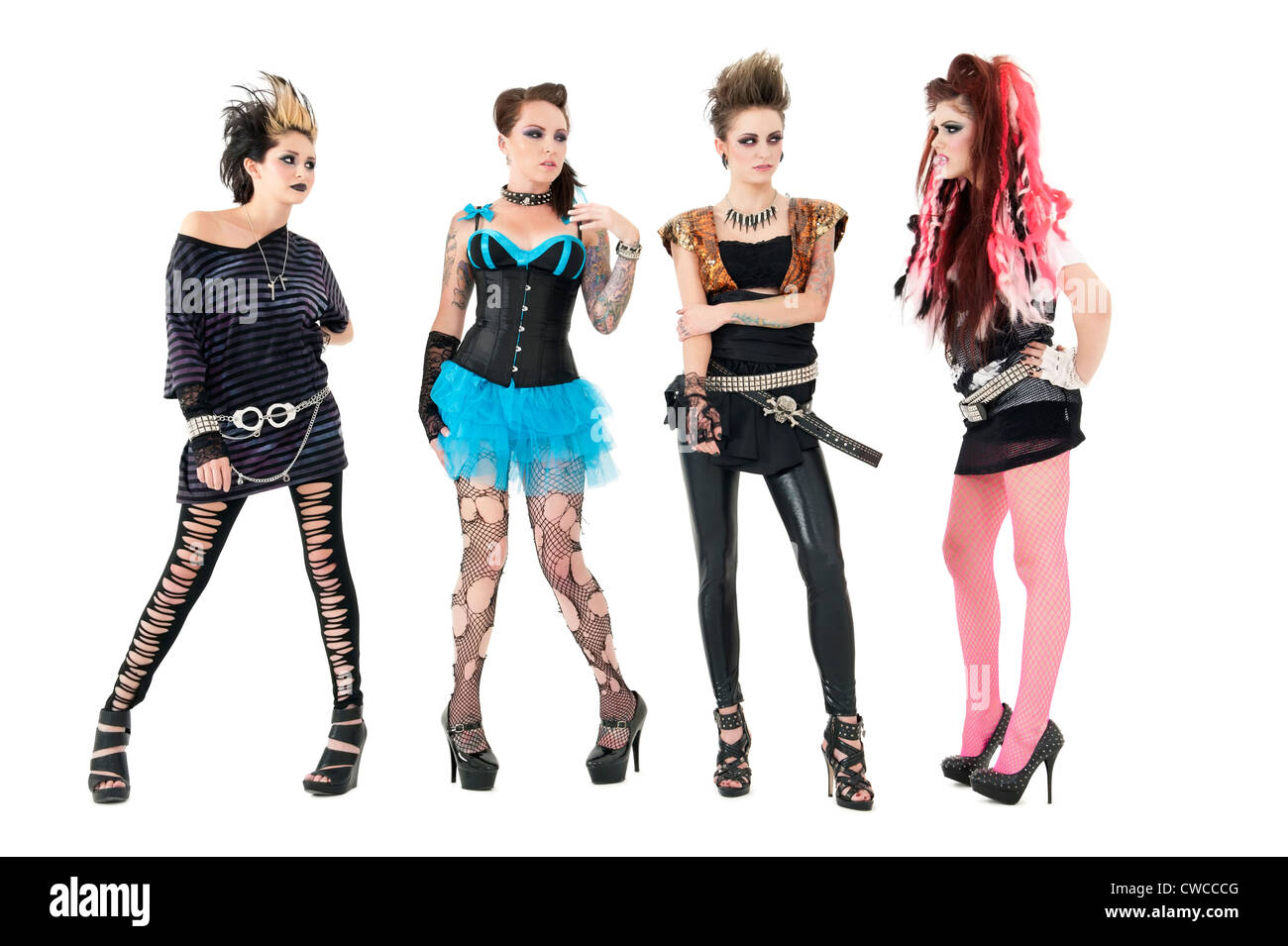All female rock band members posing over white background - Stock Image