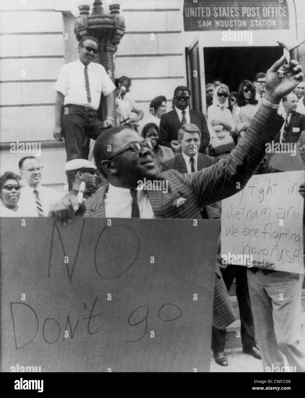Supporters of Muhammad Ali, formerly Cassius Clay, cheer on a man burning draft card in Houston, Texas. In 1967, - Stock Image