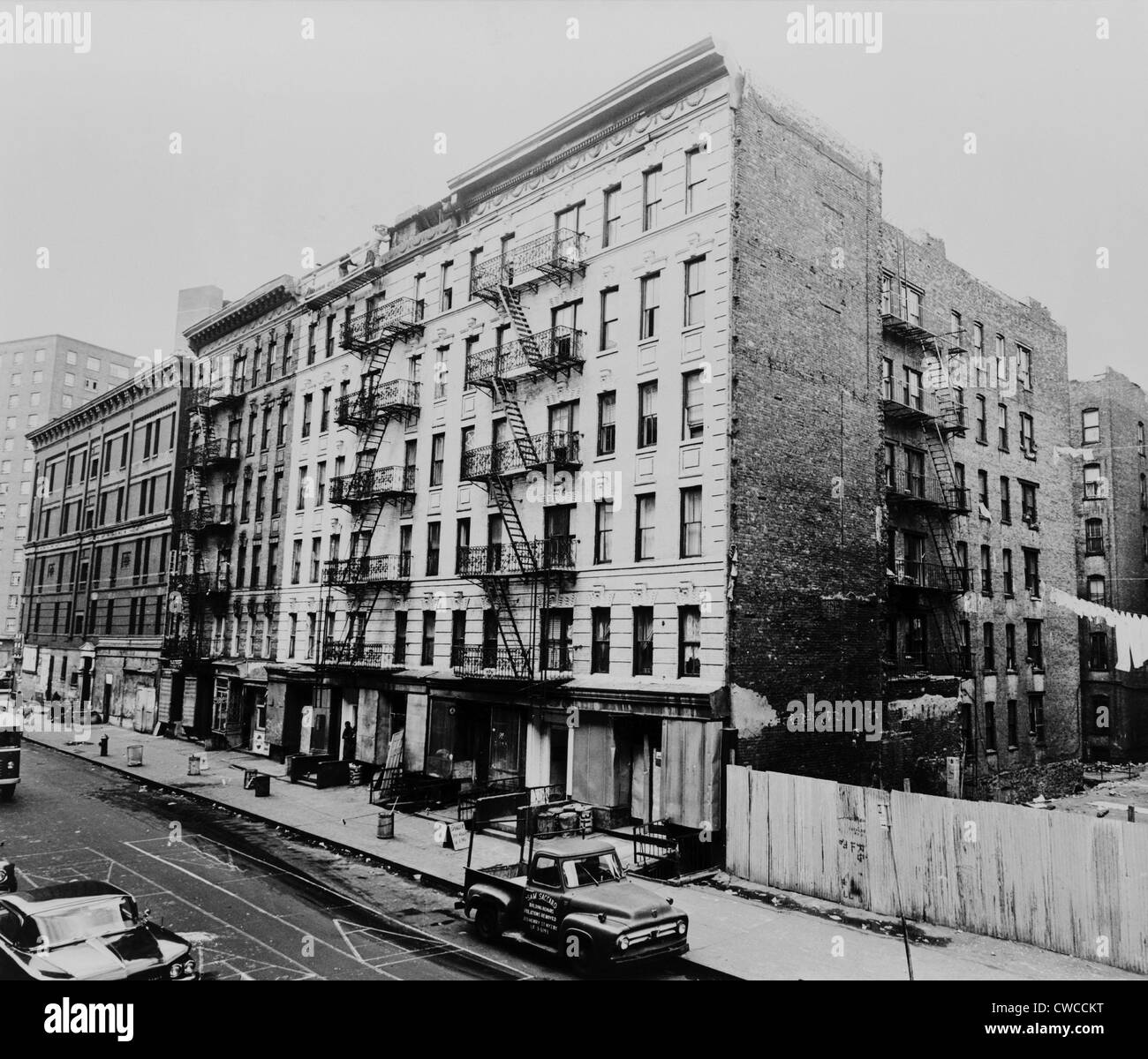 Harlem New York Apartments: East Harlem Street And Large Tenement Apartment Building