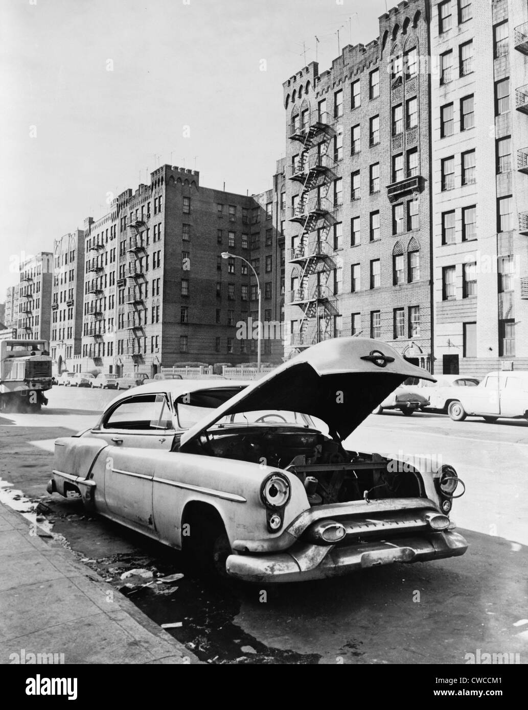 bronx street in new york city an abandoned automobile a vacant lot stock photo 50060529 alamy. Black Bedroom Furniture Sets. Home Design Ideas