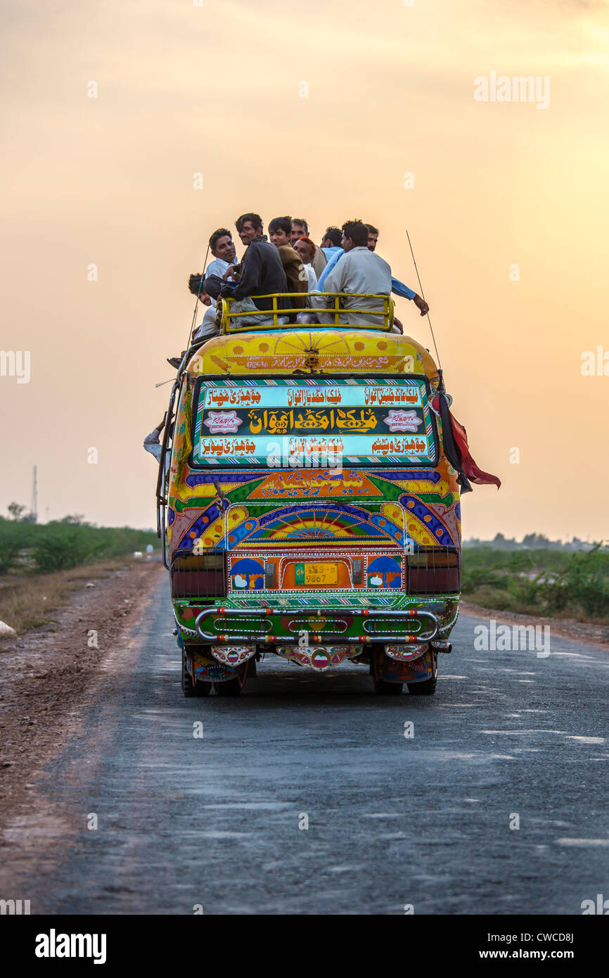 Long distance bus in rural Punjab Province, Pakistan - Stock Image