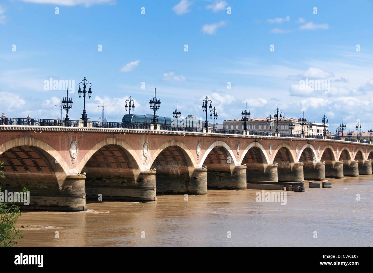 Tram crossing Pont de Pierre, Bordeaux, Gironde, France, Europe - Stock Image