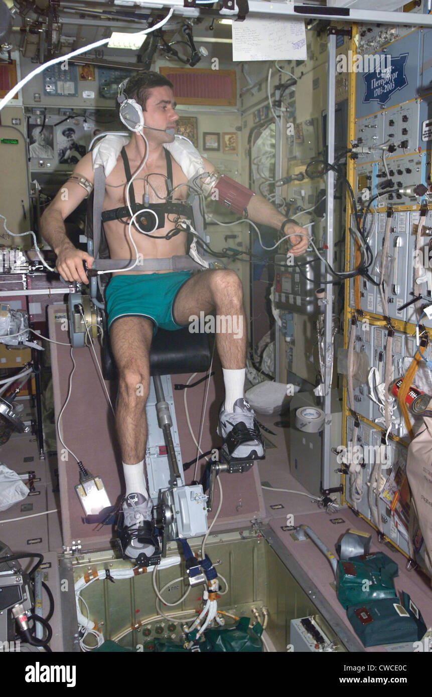 Working out in space. Cosmonaut Yuri Malenchenko exercising on the International Space Station. During this mission, - Stock Image