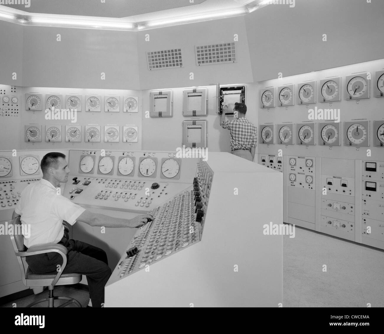 Technicians in a nuclear reactor control room at NASA's Plum Brook Station in Sandusky, Ohio. 1959. - Stock Image
