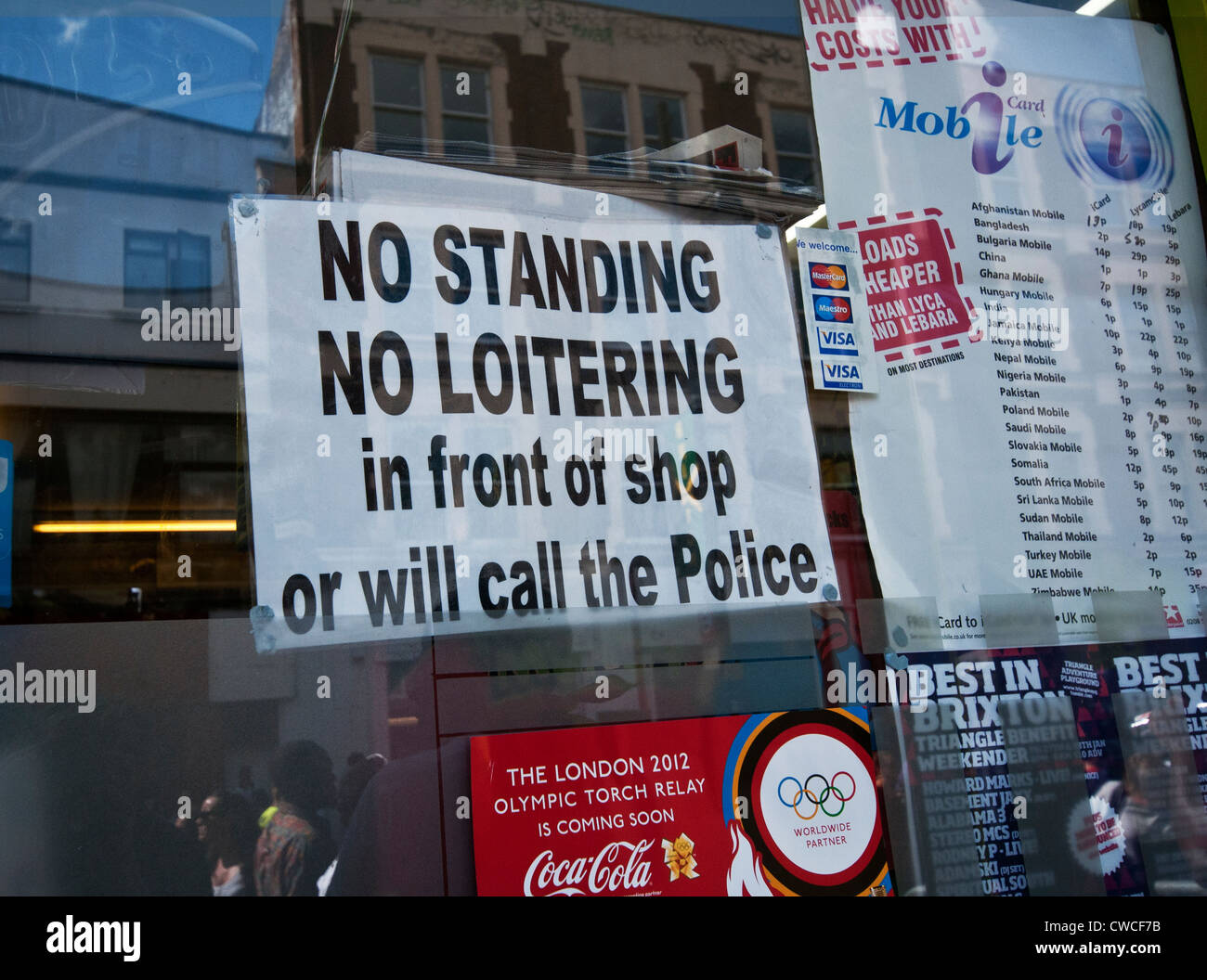 Sign in shop window saying no loitering Stock Photo: 50062527 - Alamy